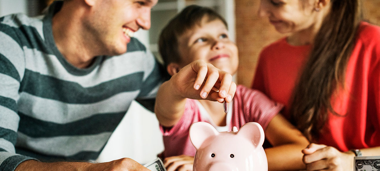Parents teaching child to save money