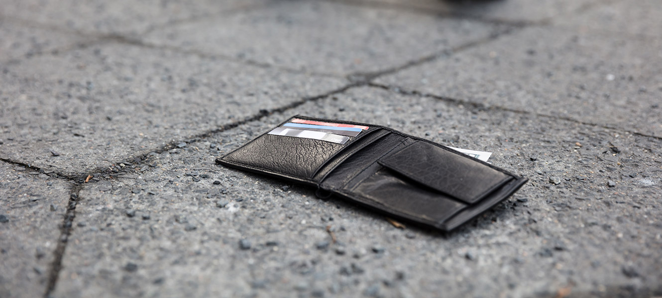 lost wallet laying on ground